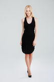 Full length portrait of a woman posing in black dress Royalty Free Stock Photo