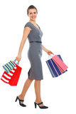 Full length portrait of woman with shopping bags Stock Image