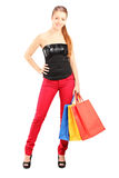 Full length portrait of a woman with shopping bags Stock Photos