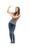 Full-length portrait of woman showing bicep Stock Photography