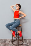 Full length portrait of a woman sitting on the chair Royalty Free Stock Photography