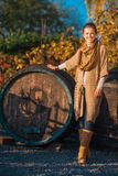 Full length portrait of woman standing in autumn vineyard Stock Photography
