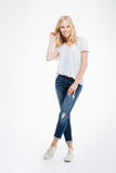 Full length portrait of a woman standing with legs crossed Stock Images
