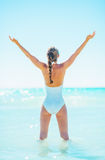 Full length portrait of woman standing in sea and rejoicing Royalty Free Stock Image