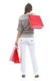 Full length portrait of woman in sweater holding  shopping bags Stock Photo