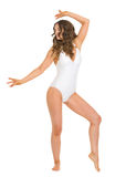 Full length portrait of woman in swimsuit dancing Stock Photo
