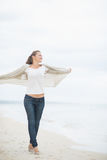 Full length portrait of woman walking on beach Royalty Free Stock Photo