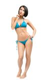 Full-length portrait of woman wearing bikini. Full-length portrait of woman wearing blue bikini, isolated on white. Concept of summer holidays and traveling royalty free stock photography
