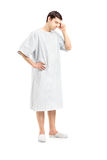 Full length portrait of a worried male patient. Isolated on white background stock photos
