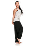 Full length portrait of a yoga woman. Full length portrait of fit young woman in sports wear standing on white background. Muscular fitness model royalty free stock photography