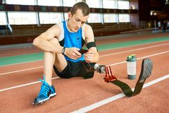 Amputee Sportsman Sitting on Floor royalty free stock image