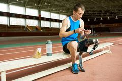 Disabled Athlete Taking Break from Training stock images