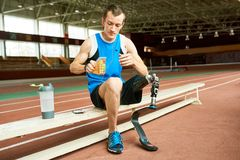 Handicapped Sportsman Taking Break from Training Royalty Free Stock Photo