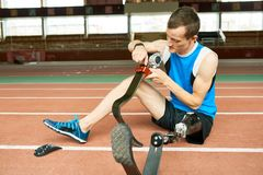 Handicapped Sportsman Fixing Prosthetic Foot royalty free stock photography