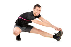 Full length portrait of a young athlete exercising Stock Photography