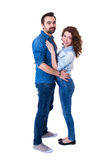 Full length portrait of young beautiful cute couple isolated on Royalty Free Stock Photography