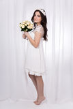 Full length portrait of young beautiful happy woman in white bri Stock Photography