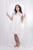 Full length portrait of young beautiful happy woman in white bri Royalty Free Stock Images