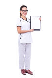 Full length portrait of young beautiful woman doctor showing cli Royalty Free Stock Photo