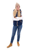 Full length portrait of young blond woman in warm clothes posing Stock Photo