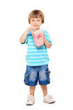 Full length portrait of young boy eating popcorn. Full length portrait of adorable young boy eating popcorn isolated against white background Royalty Free Stock Photography