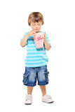 Full length portrait of a young boy eating popcorn. Isolated against white background Royalty Free Stock Images