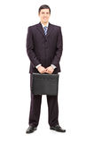 Full length portrait of a young businessman with a briefcase pos Stock Photography