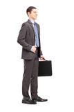 Full length portrait of a young businessman holding a briefcase Royalty Free Stock Images