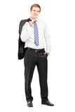 Full length portrait of a young businessman posing with a coat. Over shoulder on white background Stock Image