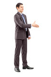 Full length portrait of a young businessman shaking hand Royalty Free Stock Photo