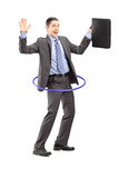 Full length portrait of a businessman in suit holding a briefcas Stock Photography