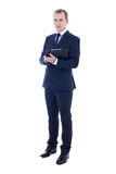 Full length portrait of young businessman in suit holding clipbo Stock Photos