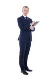 Full length portrait of young businessman in suit with pen and c Royalty Free Stock Photos