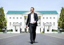 Full length portrait of a young businessman walking down the roa Royalty Free Stock Photography