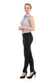 Full length portrait of young businesswoman smiling Stock Photo