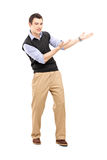 Full length portrait of a young cheerful man gesturing Royalty Free Stock Image