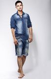 Full Length Portrait of Young Confident Barefoot Man in Blue Jeans Stock Images