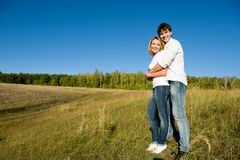 Full-length portrait young couple Stock Photography