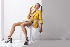 Full-length portrait young elegant woman in the yellow jacket, s Stock Image
