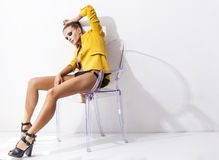 Full-length portrait young elegant woman in the yellow jacket, s Royalty Free Stock Photo
