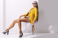 Full-length portrait young elegant woman in the yellow jacket  Royalty Free Stock Photo