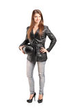 Full length portrait of a young female biker in a leather jacket Stock Photos
