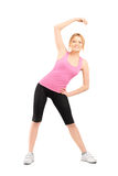 Full length portrait of a young female exercising Royalty Free Stock Photography