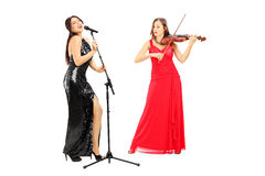 Full length portrait of a young female musicians Royalty Free Stock Image
