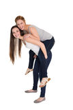 Full length portrait of a young female piggybacking friend Stock Photo