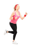 Full length portrait of a young female running Stock Photography