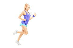 Full length portrait of a young female running. Isolated on white background royalty free stock image