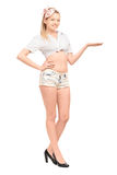 Full length portrait of a young female in short pants gesturing Stock Photos