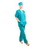 Full length portrait of young female surgeon doctor. Female intern nurse isolated on white background Royalty Free Stock Image