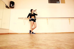 Full-length portrait of a young fit woman drinking water Royalty Free Stock Photography